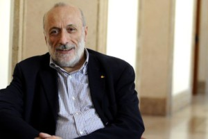 President of Slow Food Carlo Petrini smiles during an interview with an AFP journalist in Rome on September 23, 2010. Slow Food is a non-profit, eco-gastronomic organization founded in 1989. AFP PHOTO/ Tiziana Fabi