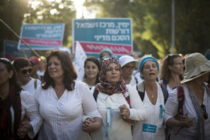 Thousands of women from the 'Women Wage Peace' movement take part in a march in support of peace  in Jerusalem on October 19, 2016. The women have been marching across the country over the past two weeks, culminating in a march from the Knesset to the Prime Minister's House in Jerusalem, demanding a peace agreement between Israel and the Palestinians. Photo by Hadas Parush/Flash90
